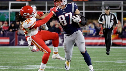 <p>               New England Patriots tight end Rob Gronkowski (87) gives a stiff arm to Kansas City Chiefs free safety Ron Parker (38) after catching a pass during the second half of an NFL football game, Sunday, Oct. 14, 2018, in Foxborough, Mass. (AP Photo/Steven Senne)             </p>