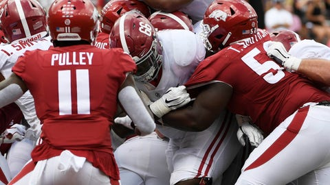 <p>               Alabama running back Damien Harris, top, pushes the ball over the goal line to score a touchdown against Arkansas in the second half of an NCAA college football game Saturday, Oct. 6, 2018, in Fayetteville, Ark. (AP Photo/Michael Woods)             </p>