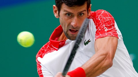 <p>               Novak Djokovic of Serbia hits a return shot to Marco Cecchinato of Italy during their men's singles match of the Shanghai Masters tennis tournament at Qizhong Forest Sports City Tennis Center in Shanghai, China, Thursday, Oct. 11, 2018. (AP Photo/Andy Wong)             </p>