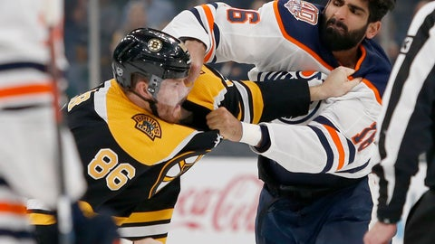 <p>               Boston Bruins defenseman Kevan Miller (86) and Edmonton Oilers left wing Jujhar Khaira (16) fight during the second period of an NHL hockey game Thursday, Oct. 11, 2018, in Boston. (AP Photo/Mary Schwalm)             </p>