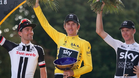 <p>               FILE - In this Sunday July 29, 2018 file picture, Tour de France winner Britain's Geraint Thomas, wearing the overall leader's yellow jersey, celebrates on the podium with Netherlands' Tom Dumoulin, left, who placed second, and Britain's Chris Froome, right, who placed third, on the Champs-Elysees avenue in Paris, France. The team said in a statement on Wednesday that police is investigating the case after the trophy disappeared during an event organized in Birmingham, where Team Sky displayed the three Grands Tours trophies won by its riders. (AP Photo/Francois Mori, File)             </p>