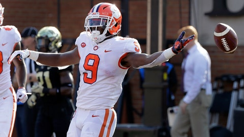 <p>               Clemson's Travis Etienne (9) celebrates his touchdown run against Wake Forest during the first half of an NCAA college football game in Charlotte, N.C., Saturday, Oct. 6, 2018. (AP Photo/Chuck Burton)             </p>
