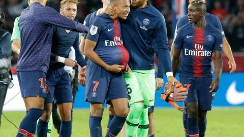 <p>               PSG's goalkeeper Alphonse Areola congratulates PSG's Kylian Mbappe after the French League One soccer match between Paris-Saint-Germain and Lyon at the Parc des Princes stadium in Paris, France, Sunday, Oct. 7, 2018. (AP Photo/Michel Euler)             </p>
