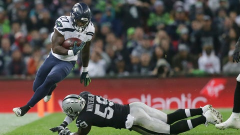 <p>               Seattle Seahawks running back Mike Davis (27), left, escapes the clutches of Oakland Raiders linebacker Tahir Whitehead (59) during the first half of an NFL football game at Wembley stadium in London, Sunday, Oct. 14, 2018. (AP Photo/Tim Ireland)             </p>