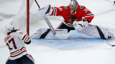 <p>               Edmonton Oilers' Connor McDavid, left, scores the winning goal against Chicago Blackhawks' Cam Ward during overtime of an NHL hockey game Sunday, Oct. 28, 2018, in Chicago. (AP Photo/Jim Young)             </p>