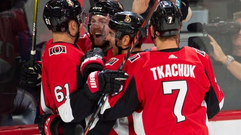 <p>               Ottawa Senators centre Chris Tierney, second from left, celebrates his goal with teammates right wing Mark Stone *(61), defenceman Dylan DeMelo (2) and left wing Brady Tkachuk (7) during first period NHL hockey action in Ottawa on Saturday, Oct. 13, 2018. (Adrian Wyld/The Canadian Press via AP)             </p>