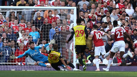 <p>               Arsenal's Mesut Ozil, 2nd right, scores his side's second goal of the game against Watford, during their English Premier League soccer match at the Emirates Stadium in London, Saturday Sept. 29, 2018. (Yui Mok/PA via AP)             </p>
