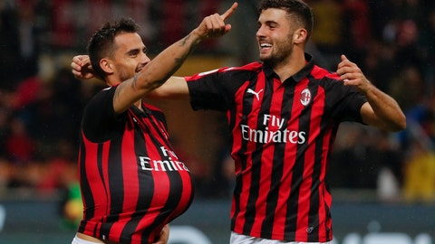<p>               AC Milan's Suso, left, celebrates with his teammate Patrick Cutrone after scoring his side's opening goal during the Serie A soccer match between AC Milan and Genoa at the San Siro Stadium in Milan, Italy, Wednesday, Oct. 31, 2018. (AP Photo/Antonio Calanni)             </p>
