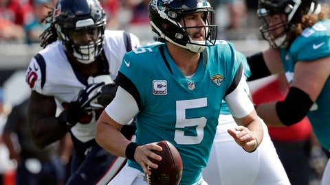 <p>               Blake Bortles (5) looks for a receiver as he is pressured by Houston Texans linebacker Jadeveon Clowney, back left, during the first half of an NFL football game, Sunday, Oct. 21, 2018, in Jacksonville, Fla. (AP Photo/John Raoux)             </p>