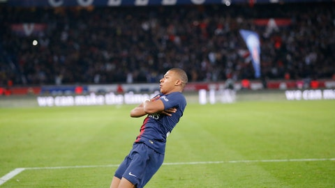 <p>               PSG's Kylian Mbappe celebrates after scoring his side's fourth goal during the French League One soccer match between Paris-Saint-Germain and Lyon at the Parc des Princes stadium in Paris, France, Sunday, Oct. 7, 2018. (AP Photo/Michel Euler)             </p>