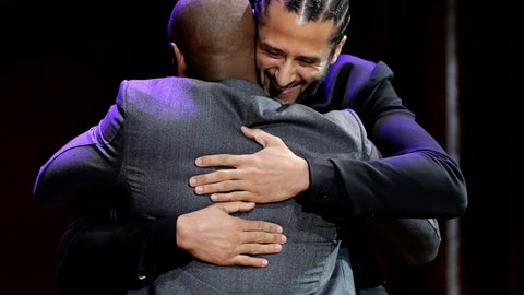<p>               Former NFL quarterback Colin Kaepernick, right, hugs comedian Dave Chappelle, left, on stage during W.E.B. Du Bois Medal award ceremonies, Thursday, Oct. 11, 2018, at Harvard University, in Cambridge, Mass. Kaepernick and Chappelle are among eight recipients of Harvard University's W.E.B. Du Bois Medals in 2018. Harvard has awarded the medal since 2000 to people whose work has contributed to African and African-American culture. (AP Photo/Steven Senne)             </p>