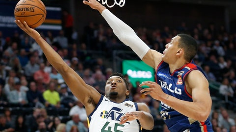 <p>               Utah Jazz guard Donovan Mitchell (45) lays the ball up as Adelaide 36ers forward Jake Wiley, right, defends during the first half during an NBA exhibition basketball game Friday, Oct. 5, 2018, in Salt Lake City. (AP Photo/Rick Bowmer)             </p>