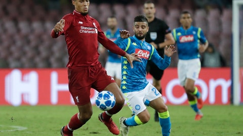 <p>               Liverpool defender Virgil Van Dijk, left, and Napoli's Lorenzo Insigne vie for the ball during the Champions League, group C soccer match between Napoli and Liverpool, at the San Paolo Stadium in Naples, Italy, Wednesday, Oct. 3, 2018. (AP Photo/Andrew Medichini)             </p>
