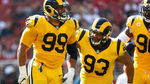 <p>               Los Angeles Rams defensive tackle Aaron Donald (99) celebrates with defensive tackle Ndamukong Suh (93) during the first half of an NFL football game against the San Francisco 49ers in Santa Clara, Calif., Sunday, Oct. 21, 2018. (AP Photo/Tony Avelar)             </p>