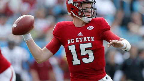 <p>               FILE - In this Sept. 2, 2017, file photo, North Carolina State's Ryan Finley (15) looks for an open receiver against South Carolina during the first half of an NCAA college football game in Charlotte, N.C. Coach Dino Babers has led Syracuse to a surprising 4-2 record midway through the season, while Clemson and North Carolina State, led by quarterback Ryan Finley, are undefeated entering a big showdown this week. All drew attention in midseason voting by AP writers covering the 14 ACC teams. (AP Photo/Bob Leverone, File)             </p>