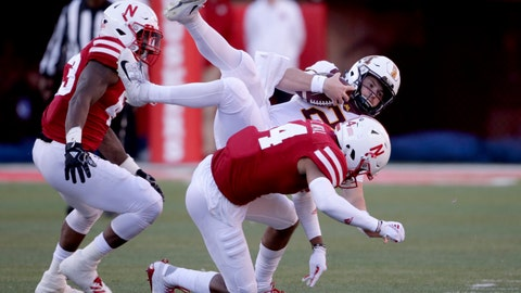 <p>               Nebraska defensive back Tre Neal (14) tackles Minnesota quarterback Tanner Morgan (2) during the second half of an NCAA college football game in Lincoln, Neb., Saturday, Oct. 20, 2018. (AP Photo/Nati Harnik)             </p>