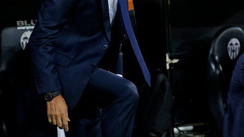 <p>               Barcelona coach Ernesto Valverde during the Spanish La Liga soccer match between Valencia and Barcelona, at the Mestalla stadium in Valencia, Spain, Sunday, Oct. 7, 2018. (AP Photo/Alberto Saiz)             </p>