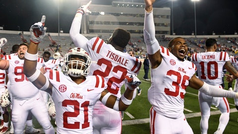 <p>               Mississippi's Javien Hamilton (21), Tariqious Tisdale (22) and Kweisi Fountain (39) celebrate after Mississippi defeated Arkansas 37-33 in an NCAA college football game Saturday, Oct. 13, 2018, in Little Rock, Ark. (AP Photo/Michael Woods)             </p>