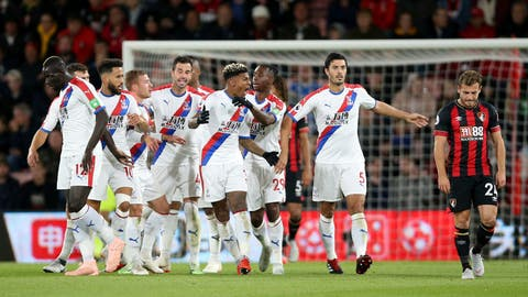 <p>               Crystal Palace's Patrick van Aanholt, center, celebrates scoring his side's first goal during the British Premier League soccer match between Bournemouth and Crystal Palace, at the Vitality Stadium in Bournemouth, England, Monday, Oct. 1, 2018. (Nigel French/PA via AP)             </p>
