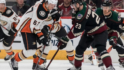 <p>               Anaheim Ducks' Rickard Rakell (67) battles for the puck with Arizona Coyotes' Oliver Ekman-Larsson (23) during the first period of an NHL hockey game Saturday, Oct. 6, 2018, in Glendale, Ariz. (AP Photo/Darryl Webb)             </p>