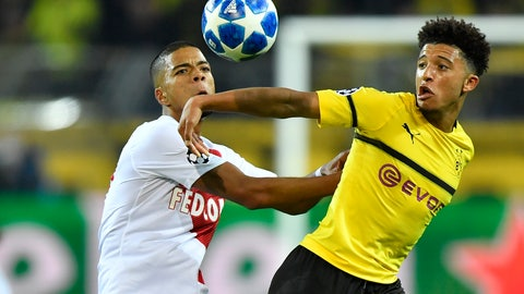 <p>               Dortmund's Jadon Sancho, right, fights for the ball with Monaco defender Benjamin Henrichs during the Champions League group A soccer match between Borussia Dortmund and AS Monaco in Dortmund, Germany, Wednesday, Oct. 3, 2018. (AP Photo/Martin Meissner)             </p>