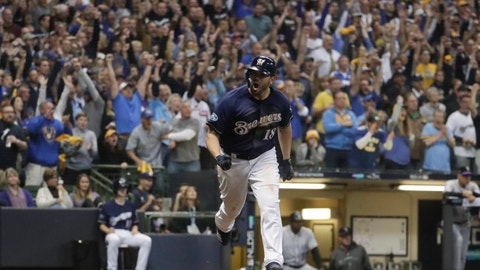 <p>               Milwaukee Brewers' Mike Moustakas reacts after hitting an RBI single during the eighth inning of Game 2 of the National League Divisional Series baseball game against the Colorado Rockies Friday, Oct. 5, 2018, in Milwaukee. (AP Photo/Morry Gash)             </p>