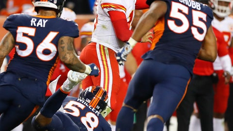 <p>               Kansas City Chiefs quarterback Patrick Mahomes (15) throws left handed for the first down as Denver Broncos linebacker Bradley Chubb (55) and linebacker Shane Ray (56) pursue during the second half of an NFL football game, Monday, Oct. 1, 2018, in Denver. (AP Photo/Jack Dempsey)             </p>