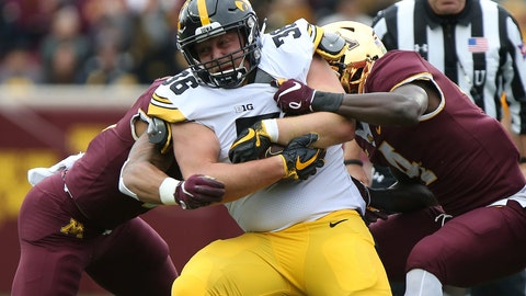<p>               FILE - In this Saturday, Oct. 6, 2018, file photo, Iowa's Mitch Riggs is tackled by Minnesota's defensive back Terell Smith during an NCAA college football game in Minneapolis. Iowa faces Indiana on Saturday. (AP Photo/Stacy Bengs, File)             </p>