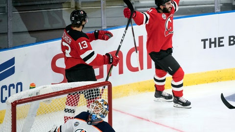 <p>               New Jersey Devils' Kyle Palmieri celebrates scoring during the season-opening NHL Global Series hockey match between Edmonton Oilers and New Jersey Devils at Scandinavium in Gothenburg, Sweden, Saturday, Oct. 6, 2018, (Bjorn Larsson Rosvall /TT News Agency via AP)             </p>