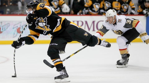 <p>               Pittsburgh Penguins' Phil Kessel, left, snaps a shot as Vegas Golden Knights' Colin Miller (6) defends during the second period of an NHL hockey game Thursday, Oct. 11, 2018, in Pittsburgh. Kessel scored on the play, his second of the period and third of the game. (AP Photo/Keith Srakocic)             </p>
