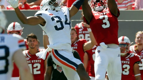 <p>               FILE - In this Sept. 29, 2018, file photo, North Carolina State's Kelvin Harmon (3) hauls a pass in against Virginia's Bryce Hall (34) during the first half of an NCAA college football game in Raleigh, N.C. Harmon has developed into the top receiver for No. 16 North Carolina State, a big-bodied threat capable of making contested catches entering Saturday's trip to No. 3 Clemson.  (AP Photo/Chris Seward, File)             </p>