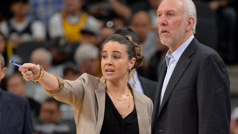 <p>               FILE - In this Feb. 6, 2016, file photo, San Antonio Spurs assistant coach Becky Hammon, left, talks to Spurs head coach Gregg Popovich, right, on the court during a timeout in the second half of an NBA basketball game against the Los Angeles Lakers in San Antonio. Popovich sees one simple way for both the NBA and women to mark real progress in the league: hire more women in positions of power. (AP Photo/Darren Abate, File)             </p>