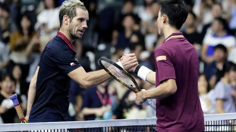 <p>               Kei Nishikori, right, of Japan shakes hands with Richard Gasquet of France after their singles semifinal match at the Japan Open men's tennis tournament in Tokyo, Saturday, Oct. 6, 2018. (AP Photo/Kiyoshi Ota)             </p>