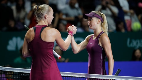 <p>               Elina Svitolina of the Ukraine, right, greet by Kiki Bertens of the Netherlands after their women's singles semi final match at the WTA tennis finals in Singapore, Saturday, Oct. 27, 2018. (AP Photo/Vincent Thian)             </p>