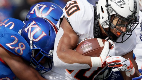 <p>               Oklahoma State running back Chuba Hubbard (30) is tackled by Kansas safety Robert Topps III (28) and linebacker Dru Prox (40) during the first half of an NCAA college football game in Lawrence, Kan., Saturday, Sept. 29, 2018. Oklahoma State defeated Kansas 48-28. (AP Photo/Orlin Wagner)             </p>