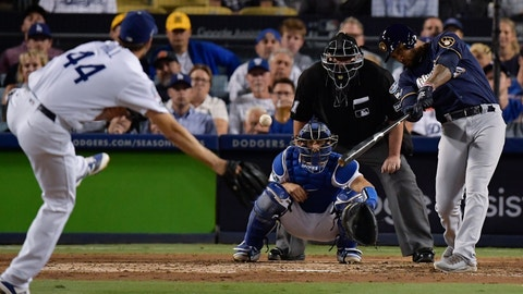 <p>               Milwaukee Brewers' Domingo Santana hits an RBI double during the sixth inning of Game 4 of the National League Championship Series baseball game against the Los Angeles Dodgers Tuesday, Oct. 16, 2018, in Los Angeles. (AP Photo/Mark J. Terrill)             </p>