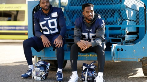 <p>               Tennessee Titans' linebacker Wesley Woodyard, left, and cornerback Logan Ryan react as they are photographed waiting their turn to give press conferences after an NFL training session at Syon House, in Syon Park, south west London, Friday, Oct. 19, 2018. The Tennessee Titans are preparing for an NFL regular season game against the Los Angeles Chargers in London on Sunday. (AP Photo/Matt Dunham)             </p>