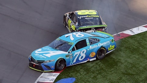 <p>               Martin Truex Jr. (78) is hit by Jimmie Johnson (48) in the last lap of the NASCAR Cup series auto race at Charlotte Motor Speedway in Concord, N.C., Sunday, Sept. 30, 2018. (AP Photo/Mike McCarn)             </p>