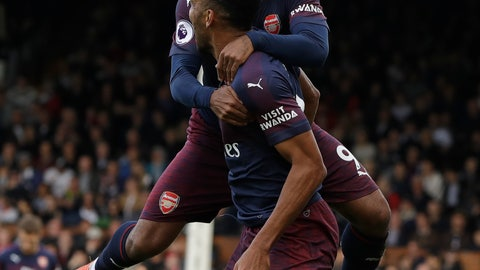 <p>               Arsenal's Pierre-Emerick Aubameyang celebrates scoring his side's fourth goal with Arsenal's Alexandre Lacazette during the English Premier League soccer match between Fulham and Arsenal at Craven Cottage stadium in London, Sunday, Oct. 7, 2018. (AP Photo/Kirsty Wigglesworth)             </p>