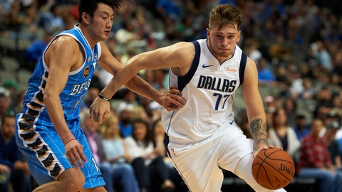 <p>               FILE - In this Saturday, Sept. 29, 2018, file photo, Dallas Mavericks guard Luka Doncic (77) drives to the basket against Beijing Ducks forward Duan Jiangpeng (11) during the second half of an NBA exhibition basketball game in Dallas. Doncic has help from plenty of angles as a teenager transitioning from European ball to the NBA with the Mavericks. (AP Photo/Cooper Neill, File)             </p>