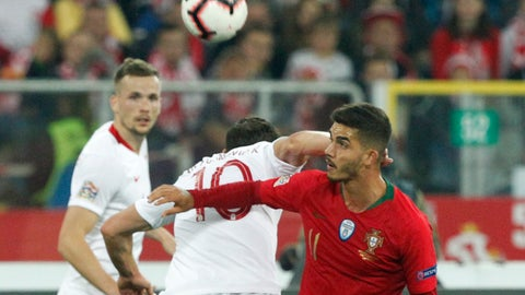 <p>               Poland's Grzegorz Krychowiak, center, hits Portugal's Andre Silva in his neck as they vie for the ball during the UEFA Nations League soccer match between Poland and Portugal at the Silesian Stadium Chorzow, Poland, Thursday Oct. 11, 2018. Krychowiak was shown a yellow card for the foul. (AP Photo/Czarek Sokolowski)             </p>