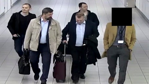 <p>               In this image released and manipulated at source by the Dutch Defense Ministry, Thursday Oct. 4, 2018, four Russian officers of the Main Directorate of the General Staff of the Armed Forces of the Russian Federation, GRU, are escorted to their flight after being expelled from the Netherlands on April 13, 2018, for allegedly trying to hack into the U.N. chemical watchdog OPCW's network. The Dutch defense minister on Thursday Oct. 4, 2018, accused Russia's military intelligence unit of attempted cybercrimes targeting the U.N. chemical weapons watchdog and the investigation into the 2014 Malaysian Airlines crash over Ukraine.(Dutch Defense Ministry via AP)             </p>