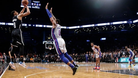 <p>               Brooklyn Nets' Spencer Dinwiddie (8) shoots a 3-pointer over Detroit Pistons' Andre Drummond (0) during overtime in an NBA basketball game Wednesday, Oct. 31, 2018, in New York. The Nets won 120-119. (AP Photo/Frank Franklin II)             </p>