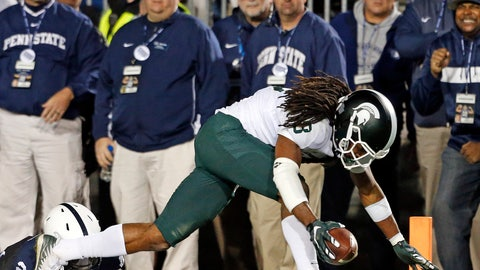 <p>               Michigan State's Felton Davis (18) goes in for the winning touchdown after a catch as Penn State's Amani Oruwariye (21) misses the tackle during the second half of an NCAA college football game in State College, Pa., Saturday, Oct. 13, 2018. (AP Photo/Chris Knight)             </p>