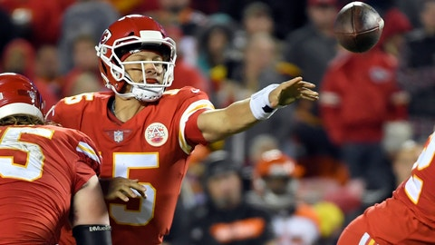 <p>               Kansas City Chiefs quarterback Patrick Mahomes (15) throws away the ball with his left hand as he is tackled by Cincinnati Bengals defensive tackle Andrew Billings, rear, in the second half of an NFL football game in Kansas City, Mo., Sunday, Oct. 21, 2018. (AP Photo/Reed Hoffmann)             </p>
