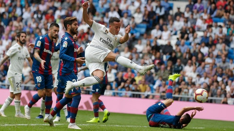 <p>               Real Madrid's Lucas Vazquez takes a shot on goal during a Spanish La Liga soccer match between Real Madrid and Levante at the Santiago Bernabeu stadium in Madrid, Spain, Saturday, Oct. 20, 2018. (AP Photo/Paul White)             </p>