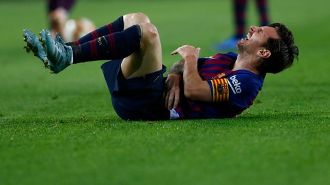 <p>               FC Barcelona's Lionel Messi looks painful injured during the Spanish La Liga soccer match between FC Barcelona and Sevilla at the Camp Nou stadium in Barcelona, Spain, Saturday, Oct. 20, 2018. (AP Photo/Manu Fernandez)             </p>