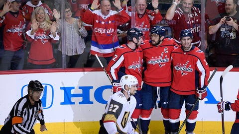 <p>               Washington Capitals left wing Alex Ovechkin, top center, of Russia, celebrates his goal with Matt Niskanen, top right, and Evgeny Kuznetsov, of Russia, during the third period of an NHL hockey game as Vegas Golden Knights defenseman Shea Theodore (27) skates by, Wednesday, Oct. 10, 2018, in Washington. The Capitals won 5-2. (AP Photo/Nick Wass)             </p>