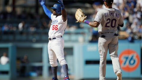 <p>               Los Angeles Dodgers' Yasiel Puig, left, reacts to his double as Colorado Rockies' Ian Desmond watches during the fourth inning of a tiebreaker baseball game, Monday, Oct. 1, 2018, in Los Angeles. (AP Photo/Jae C. Hong)             </p>