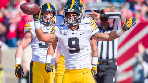 <p>               Iowa defensive back Geno Stone (9) reacts after catching an interception in the end zone during the second half of an NCAA college football game against Indiana, Saturday, Oct. 13, 2018, in Bloomington, Ind. Iowa won 42-16. (AP Photo/Doug McSchooler)             </p>